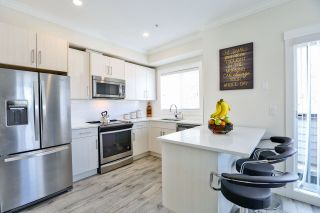 """Photo 7: 39 7247 140 Street in Surrey: East Newton Townhouse for sale in """"Greenwood Townhomes"""" : MLS®# R2256026"""