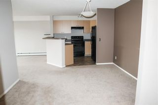 Photo 3: 8427 304 MACKENZIE Way SW: Airdrie Apartment for sale : MLS®# C4285235