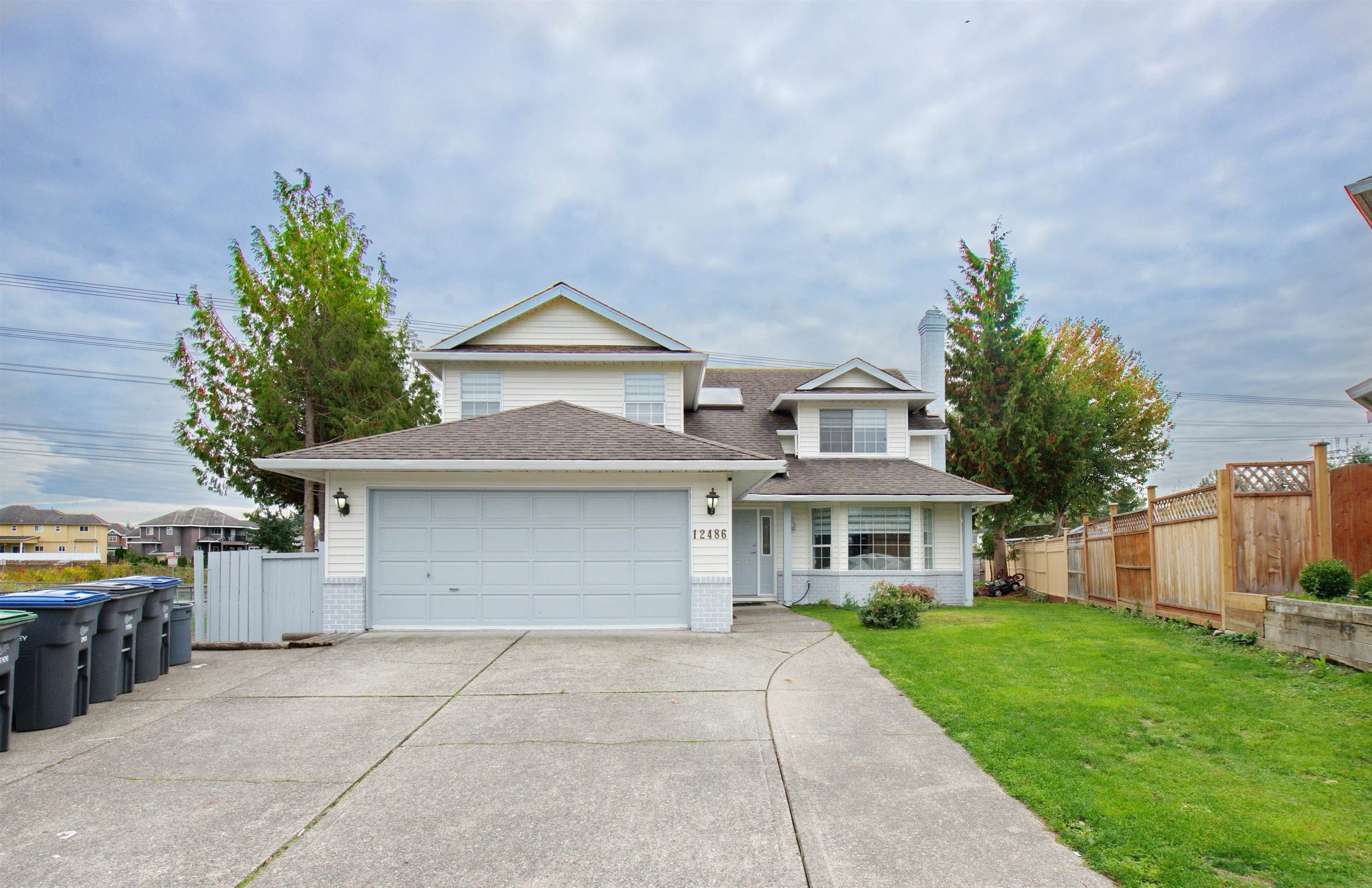 Main Photo: 12486 69 Avenue in Surrey: West Newton House for sale : MLS®# R2624475