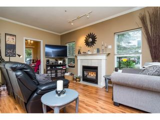 """Photo 4: 106 33502 GEORGE FERGUSON Way in Abbotsford: Central Abbotsford Condo for sale in """"Carina Court"""" : MLS®# R2262879"""