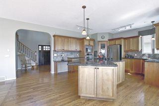 Photo 8: 60 Gleneagles Close: Cochrane Detached for sale : MLS®# A1108593