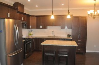 """Photo 13: 6854 208 Street in Langley: Willoughby Heights Condo for sale in """"Milner Heights"""" : MLS®# R2603848"""