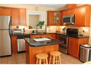 Photo 4: 82 CRYSTAL SHORES Cove: Okotoks Townhouse for sale : MLS®# C3619888