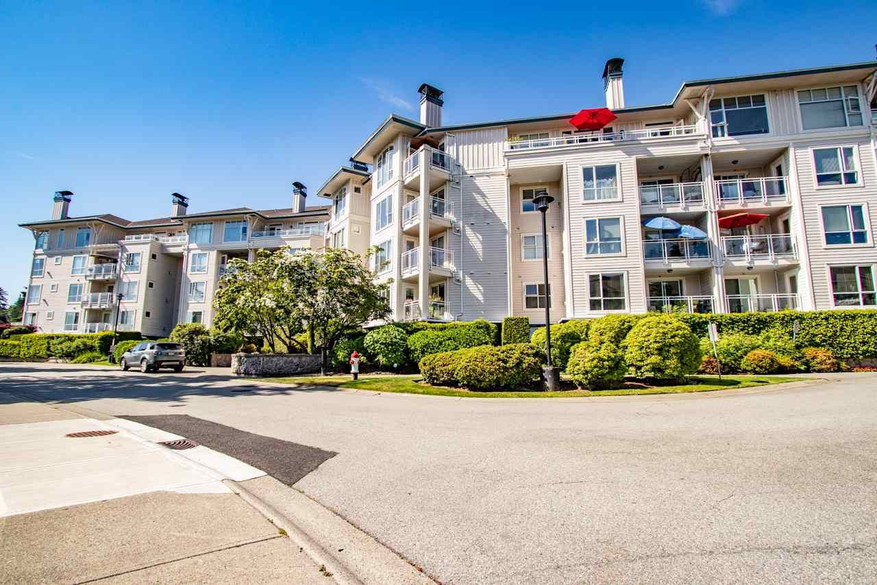 "Main Photo: 218 3608 DEERCREST Drive in North Vancouver: Roche Point Condo for sale in ""DEERFIELD AT RAVENWOODS"" : MLS®# R2418944"