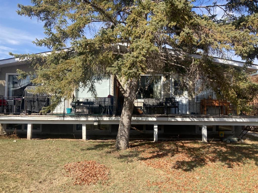Main Photo: 3914 12 Avenue SW in Calgary: Rosscarrock Duplex for sale : MLS®# A1089004