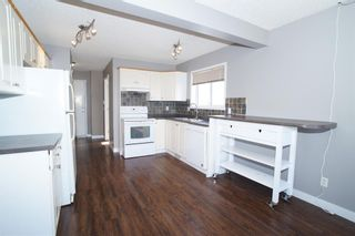 Photo 10: 117 Coverdale Road NE in Calgary: Coventry Hills Detached for sale : MLS®# A1075878