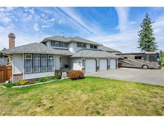 """Photo 2: 6495 180 Street in Surrey: Cloverdale BC House for sale in """"Orchard Ridge"""" (Cloverdale)  : MLS®# R2396953"""