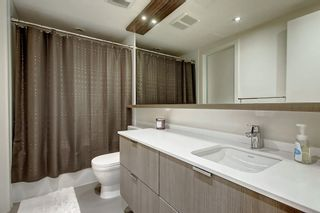 Photo 17: 114 51 WATERFRONT Mews SW in Calgary: Chinatown Apartment for sale : MLS®# C4301606
