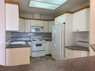 Photo 4: 107 200 Patina Court SW in Calgary: Patterson Apartment for sale : MLS®# A1093695