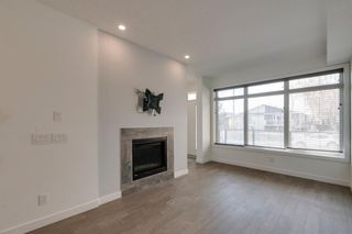 Photo 11: 104 1616 24th Ave NW in Calgary: Capitol Hill Row/Townhouse for sale : MLS®# A1104099