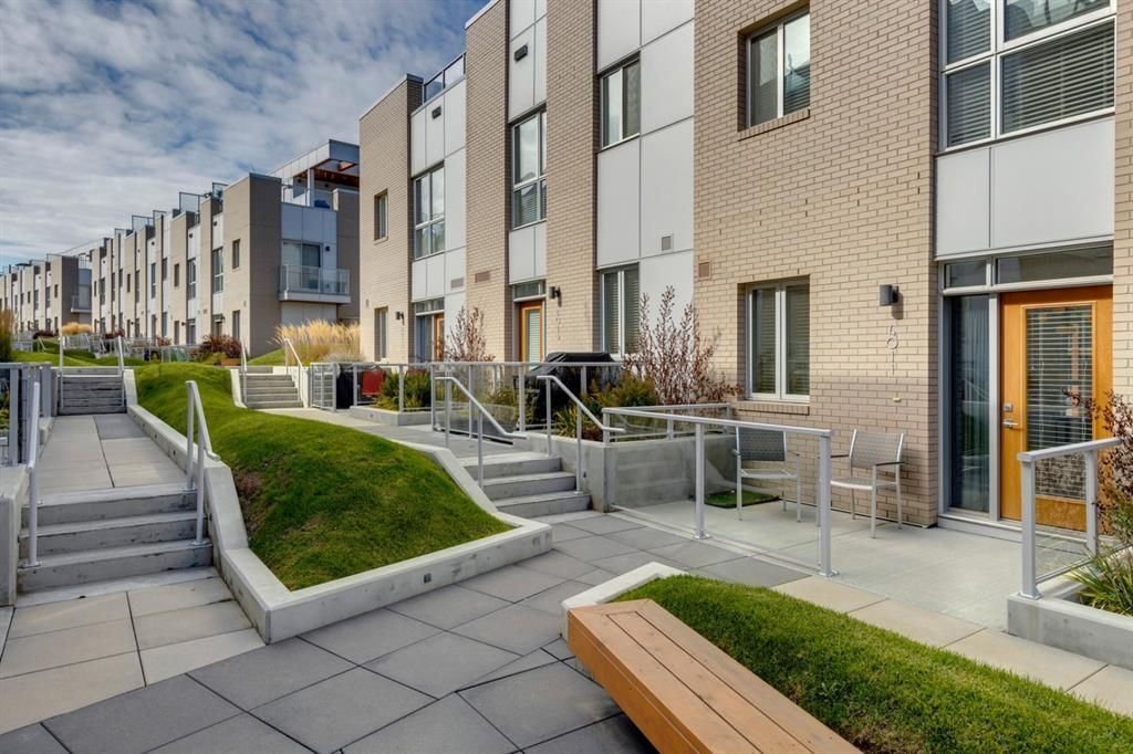 Located in the heart of the University District, this stunning three story townhome shows as new!