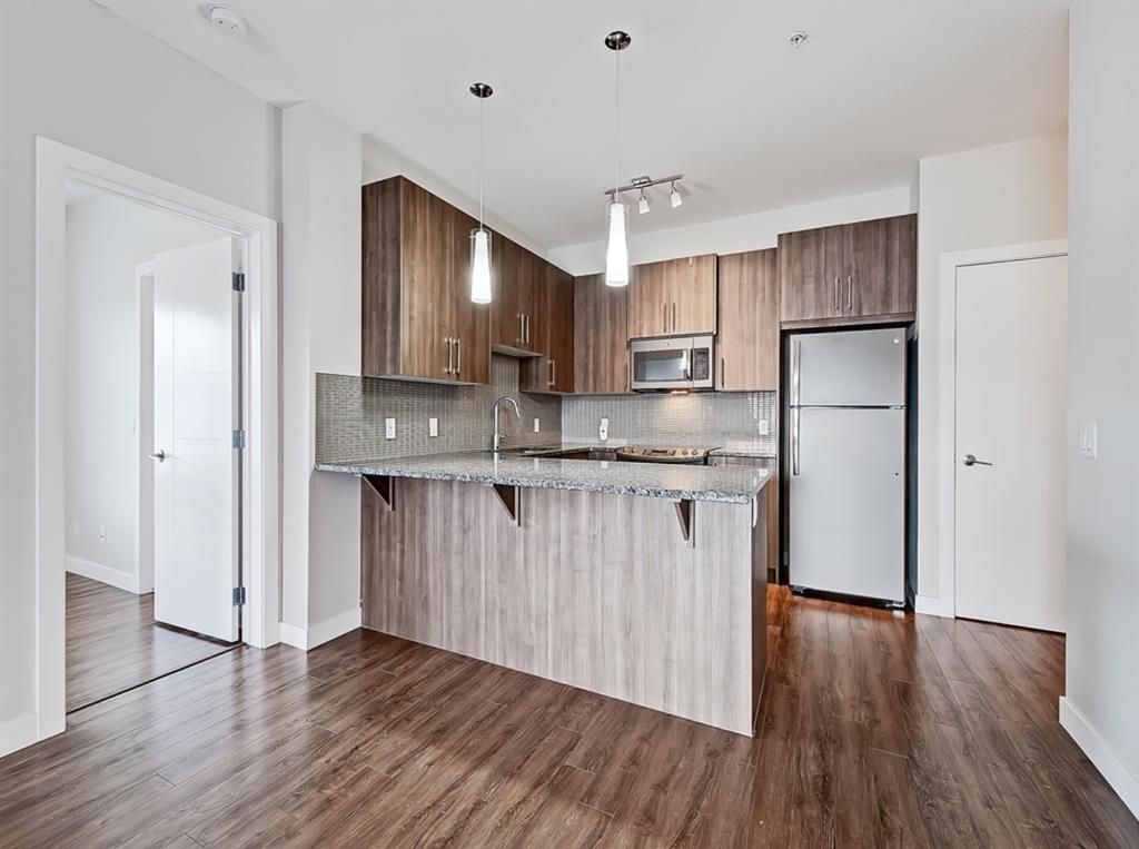Main Photo: 113 8 Sage Hill Terrace NW in Calgary: Sage Hill Apartment for sale : MLS®# A1114943