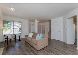 """Photo 3: 210 13900 HYLAND Road in Surrey: East Newton Townhouse for sale in """"Hyland Grove"""" : MLS®# R2295690"""