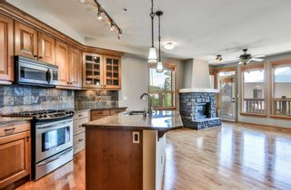 Photo 2: 301 701 Benchlands Trail: Canmore Apartment for sale : MLS®# A1019665