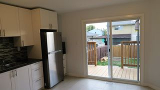 Photo 2: 302 Fonda Way SE in Calgary: Forest Heights Semi Detached for sale : MLS®# A1149324