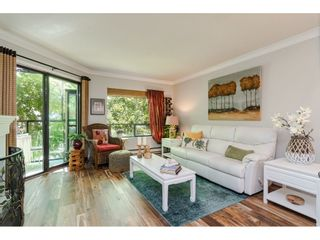 """Photo 1: 304 14950 THRIFT Avenue: White Rock Condo for sale in """"The Monterey"""" (South Surrey White Rock)  : MLS®# R2526137"""