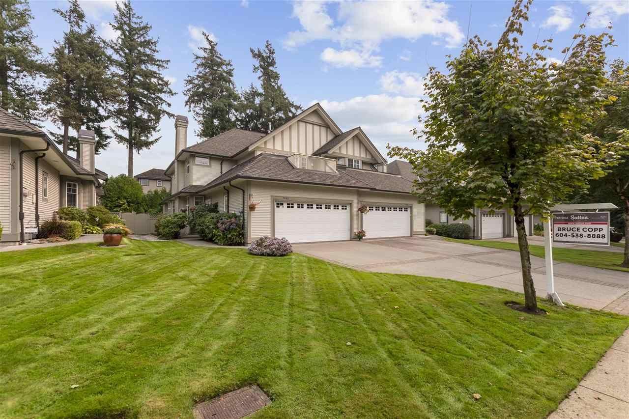 "Main Photo: 5822 122 Street in Surrey: Panorama Ridge Townhouse for sale in ""LakeBridge"" : MLS®# R2523031"