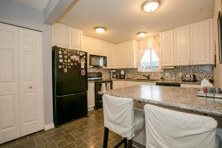 """Photo 6: 404 2733 ATLIN Place in Coquitlam: Coquitlam East Condo for sale in """"ATLIN COURT"""" : MLS®# R2232992"""