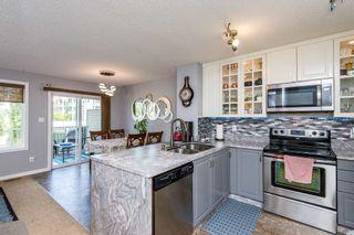 Photo 3: 24 9231 213 Street in Edmonton: Zone 58 House Half Duplex for sale : MLS®# E4251636