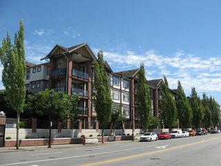 """Photo 1: 430 5660 201A Street in Langley: Langley City Condo for sale in """"Paddington Station"""" : MLS®# R2596391"""