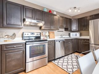 Photo 4: 1 3620 51 Street SW in Calgary: Glenbrook Row/Townhouse for sale : MLS®# C4198558