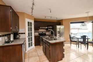 Photo 12: 93 ARBOUR RIDGE Park NW in Calgary: Arbour Lake Detached for sale : MLS®# A1026542