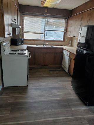 Photo 5: 405 MILLBOURNE Road E in Edmonton: Zone 29 House Half Duplex for sale : MLS®# E4238189