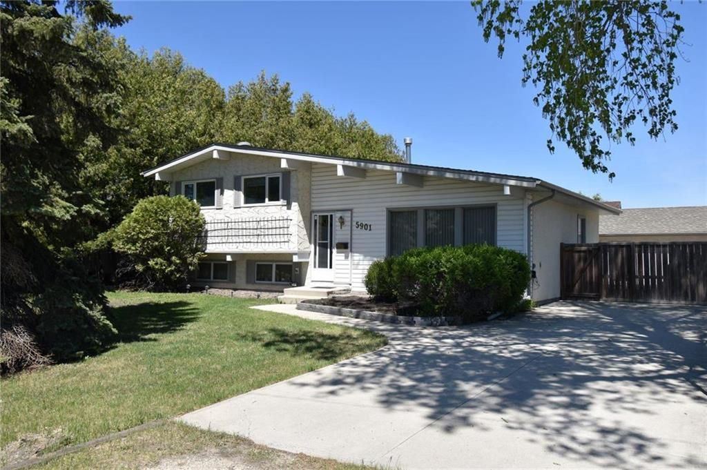 Front of house on a large treed lot. Easy care large tripane pvc windows throughout the house.