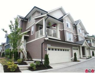 """Photo 1: 94 6575 192ND Street in Surrey: Clayton Townhouse for sale in """"Ixia"""" (Cloverdale)  : MLS®# F2905243"""