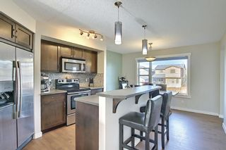 Photo 5: 144 PANAMOUNT Way NW in Calgary: Panorama Hills Semi Detached for sale : MLS®# A1114610