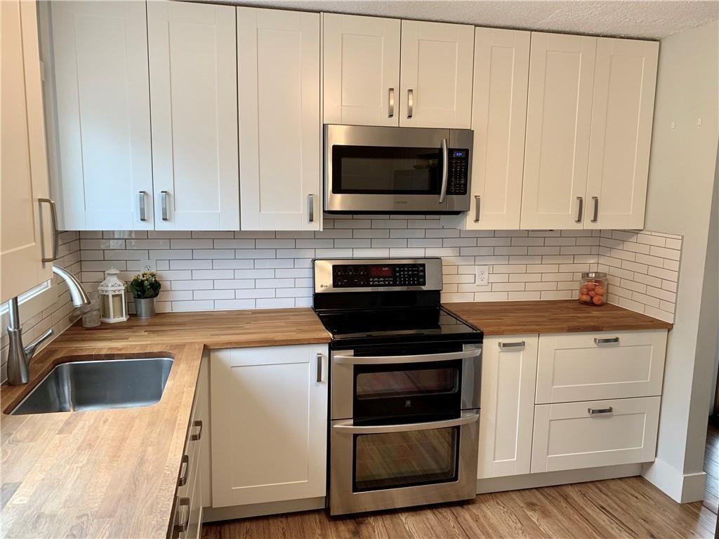 Main Photo: 2125 80 Avenue SE in Calgary: Ogden Detached for sale : MLS®# C4267037