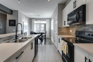 Photo 9: 604 Walden Circle SE in Calgary: Walden Row/Townhouse for sale : MLS®# A1083778