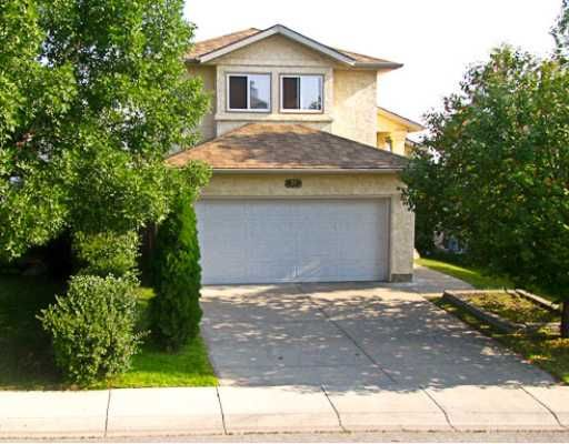 Great looking Stucco home in Shawnessy.  South facing walk-out on a quiet street