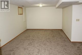 Photo 16: 11 Erminedale Bay N in Lethbridge: House for sale : MLS®# A1093060
