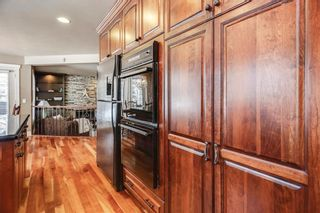 Photo 9: 74 SHAWNEE CR SW in Calgary: Shawnee Slopes House for sale : MLS®# C4226514