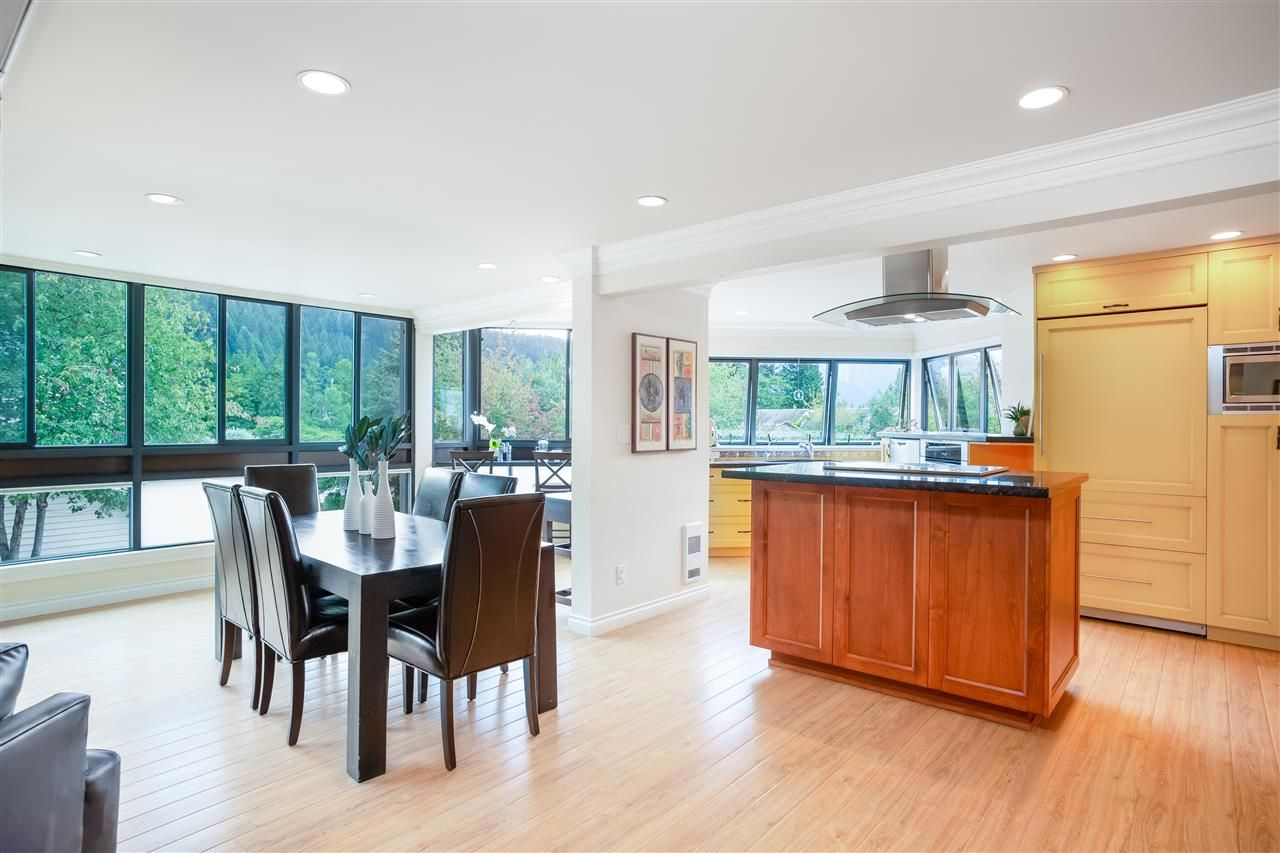 """Main Photo: 102 2181 PANORAMA Drive in North Vancouver: Deep Cove Condo for sale in """"Panorama Place"""" : MLS®# R2496386"""