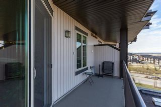 Photo 35: 2407 15 SUNSET Square: Cochrane Apartment for sale : MLS®# A1072593