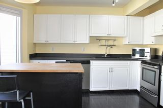 Photo 4: 5473 Patina Drive SW in Calgary: Patterson Row/Townhouse for sale : MLS®# A1147112