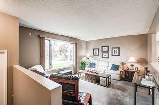 Main Photo: 2806 Rundlelawn Road NE in Calgary: Rundle Duplex for sale : MLS®# A1131798