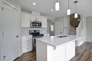 Photo 9: 16611 14 Avenue in Edmonton: Zone 56 House Half Duplex for sale : MLS®# E4248424