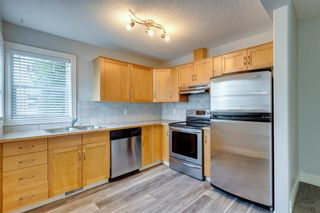 Photo 7: 249 Bridlewood Lane SW in Calgary: Bridlewood Row/Townhouse for sale : MLS®# A1124239