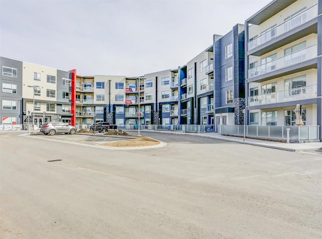 Main Photo: 205 8530 8A Avenue SW in Calgary: West Springs Apartment for sale : MLS®# A1080205