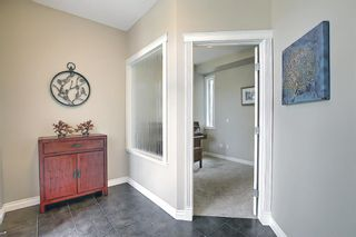 Photo 6: 47 ASPENSHIRE Drive SW in Calgary: Aspen Woods Detached for sale : MLS®# A1106772