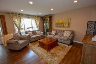 """Photo 2: 10004 117 Avenue in Fort St. John: Fort St. John - City NW 1/2 Duplex for sale in """"GARRISON LANDING"""" (Fort St. John (Zone 60))  : MLS®# R2395765"""