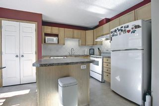 Photo 9: 403 950 Arbour Lake Road NW in Calgary: Arbour Lake Row/Townhouse for sale : MLS®# A1140525