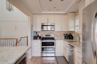 Photo 10: 1 1220 Prominence Way SW in Calgary: Patterson Row/Townhouse for sale : MLS®# A1144059