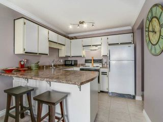 "Photo 5: 401 450 BROMLEY Street in Coquitlam: Coquitlam East Condo for sale in ""BROMELY"" : MLS®# V1114021"