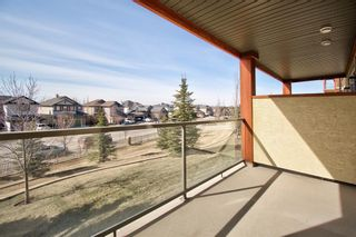 Photo 14: 1208 92 Crystal Shores Road: Okotoks Apartment for sale : MLS®# A1089465