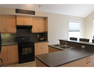 Photo 5: 68 CRYSTAL SHORES Place: Okotoks House for sale : MLS®# C4066673