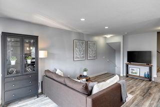 Photo 5: 912 Redstone View NE in Calgary: Redstone Row/Townhouse for sale : MLS®# A1136349